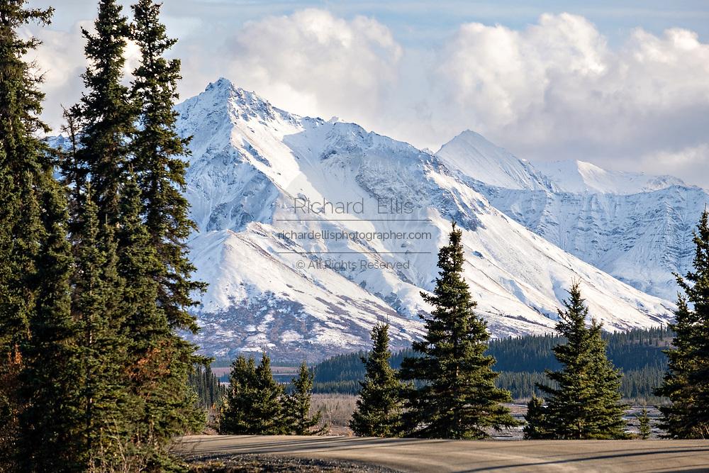 An early season snow dusting the Alaskan Range of mountains at the Teklanika River in Denali National Park, McKinley Park, Alaska
