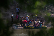Suspected smugglers load men, women and children into a raft on the Mexican side of the Rio Grande just before illegally crossing the Mexico-U.S. border near McAllen, Texas, U.S., May 9, 2018.