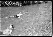Families go on a picnic to the river to swim and cool off.