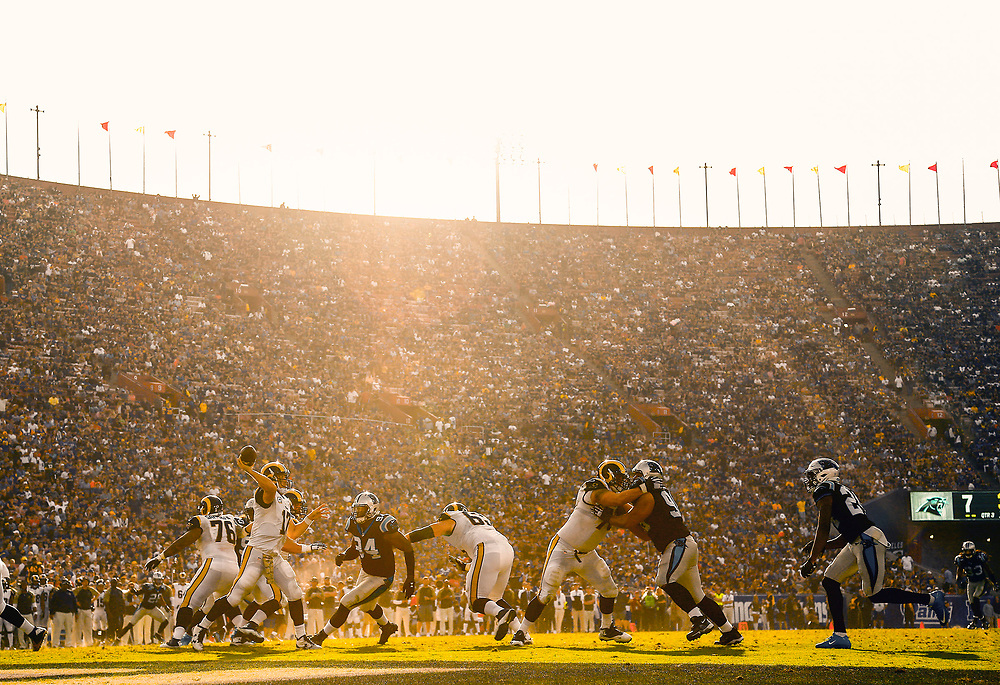 Los Angeles Rams quarterback Case Keenum (17) looks to pass as the sun sets behind Los Angeles Memorial Coliseum during the second half of an NFL football game against the Carolina Panthers, Sunday, Nov. 6, 2016, in Los Angeles. (AP Photo/Ryan Kang)