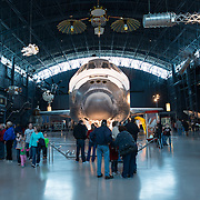 Tourists visit the space hangar at the Smithsonian Air and Space Museum. The decommissioned Space Shuttle Discovery is on permanent display in the James S. McDonnell Space Hangar at the Smithsonian's National Air and Space Museum's Udvar-Hazy Center in Chantilly, Virginia, just outside Washington DC. The shuttle arrived at the museum on April 19, 2012, and replaces the Space Shuttle Enterprise.