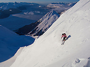 A backcountry skier enjoying mid-winter powder and sun, Turnagain Pass, Alaska.