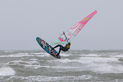 © Licensed to London News Pictures. 04/10/2020. Wittering, UK. Kite surfers enjoy strong winds at West Wittering Beach caused by Storm Alex. The storm has brought strong winds and heavy rain. Photo credit : Tom Nicholson/LNP