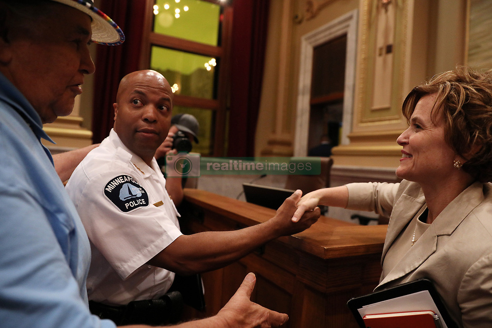 """August 9, 2017 - Minneapolis, MN, USA - Acting police chief Medaria """"Rondo"""" Arradondo shook hands with Mayor Betsy Hodges as local activist Clyde Bellecourt patted him on the shoulder following the public hearing.The Minneapolis City Council's Public Safety, Civil Rights and Emergency Management Committee held a public hearing on the nomination of Medaria """"Rondo"""" Arradondo to be the City's next police chief Wednesday, Aug. 9, 2017 at City Hall. (Credit Image: © Anthony Souffle/TNS via ZUMA Wire)"""