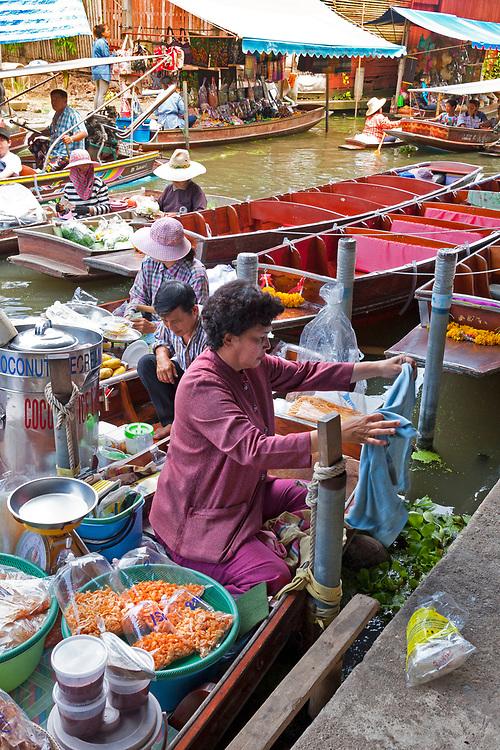 Elderly female food vendor at the Damnoen Saduak Floating Market, Thailand, SE Asia