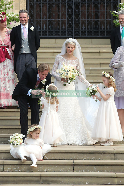 Newlyweds Thomas Kingston and Lady Gabriella Windsor with their bridesmaids and guests on the steps of the chapel after their wedding at St George's Chapel in Windsor Castle.