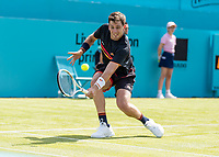 Tennis - 2019 Queen's Club Fever-Tree Championships - Day One, Monday<br /> <br /> Men's Singles, First Round: Cameron Norrie (GBR) Vs. Kevin Anderson (RSA)  <br /> <br /> Cameron Norrie (GBR) stoops to reach the ball on Centre Court.<br />  <br /> COLORSPORT/DANIEL BEARHAM