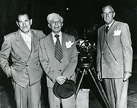 1949 Sid Grauman (center) at his Chinese Theater