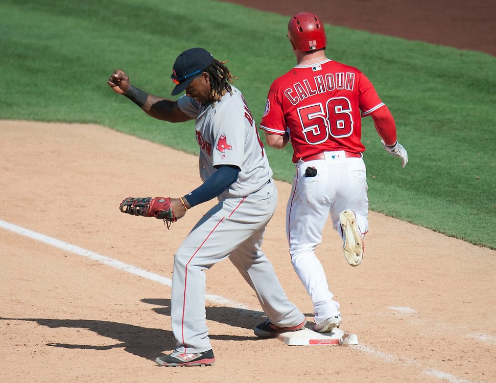 The Red Sox' Hanley Ramirez celebrates as the Angels' Kole Calhoun grounds into a game-ending double play during the Angels' 5-3 loss to Boston at Angel Stadium on Sunday.<br /> <br /> ///ADDITIONAL INFO:   <br /> <br /> angels.0730.kjs  ---  Photo by KEVIN SULLIVAN / Orange County Register  -- 7/31/16<br /> <br /> The Los Angeles Angels take on the Boston Red Sox at Angel Stadium.