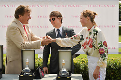 Left to right, THEO FENNELL, TOM CRUISE and EDIE CAMPBELL at the 2014 Glorious Goodwood Racing Festival at Goodwood racecourse, West Sussex on 31st July 2014.