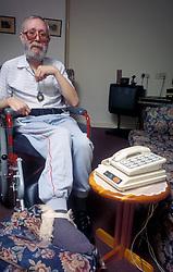 Elderly man wearing safe and sound alarm London UK