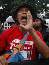 September 11, 2017 - Manila, Philippines - A protester shouts slogans during a rally coinciding the 100th birth anniversary of the late Philippine strongman Ferdinand Marcos at the Heroes' Cemetery in Taguig City, south of Manila, Philippines on Monday, September 11, 2017. (Credit Image: © Richard James Mendoza/NurPhoto via ZUMA Press)