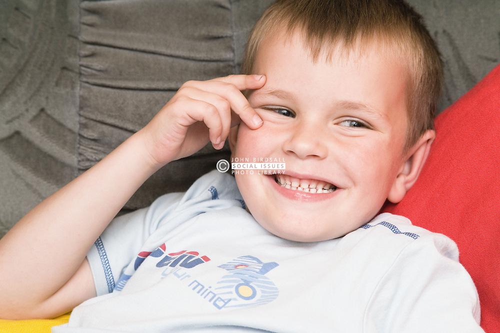 Close up of Polish boy laughing,
