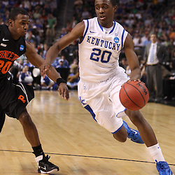 Mar 17, 2011; Tampa, FL, USA; Kentucky Wildcats guard Doron Lamb (20) drives past Princeton Tigers guard Douglas Davis (20) during first half of the second round of the 2011 NCAA men's basketball tournament at the St. Pete Times Forum.  Mandatory Credit: Derick E. Hingle