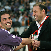 Istanbul BBSpor's coach Abdullah AVCI (R) and Galatasaray's Arda TURAN (L) during their Turkish soccer superleague match Istanbul BBSpor between Galatasaray at the Ataturk Olympic stadium in Istanbul Turkey on Saturday 01 May 2010. Photo by TURKPIX