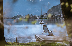 THEMENBILD - ein Segelboot ankert im Zeller See, im Hintergrund die Stadt Zell am See, aufgenommen am 20. April 2019, Zell am See, Österreich // a sailboat anchors in the Zeller lake, in the background the town Zell am See on 2019/04/20, Zell am See, Austria. EXPA Pictures © 2019, PhotoCredit: EXPA/ Stefanie Oberhauser