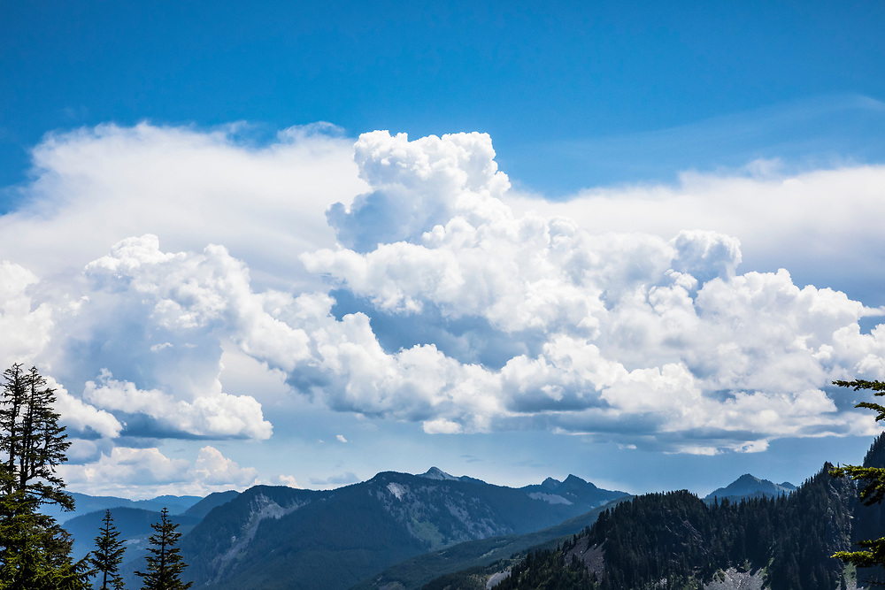 Mountains and clouds above Interstate 90 through the central Cascade mountains just East of McClellan Butte, Washington, USA