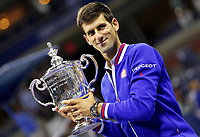 Novak Djokovic of Serbia smiles with the winner's trophy during Men's final of Tennis US Open at Flushing Meadow stadium in New York, USA, on september 13, 2015 -  Photo Ella Ling / BPI / DPPI