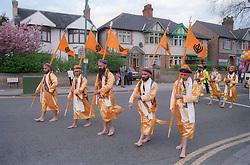 Parade of standardbearers at Sikh Festival in Hyson Green; Nottingham,