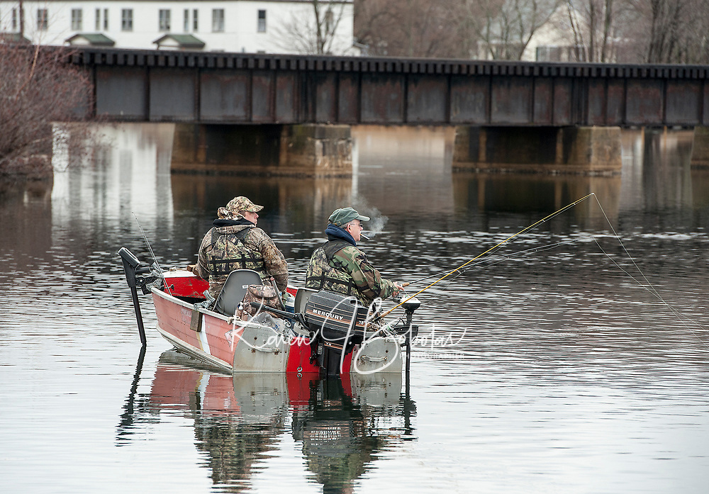 Fisherman cast their lines in the Winnipesaukee River Monday morning for opening day of Salmon season.  (Karen Bobotas/for the Laconia Daily Sun)