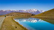 The Southern Alps reflected in the Tekapo Canal, Lake Tekapo, Canterbury, South Island, New Zealand