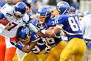 Peyton Thompson (19), Vince Buhagiar (36), and James Orth (81) battle to stop Boise State quarterback, Mike Coughlin (7), Saturday, Oct. 16, 2010, at Spartan Stadium in San Jose. Boise State beat the Spartans, 48-0. Boise State is the fifth ranked team San Jose State has faced this season. Photo by: Stan Olszewski.