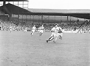 Armagh who is in possession of the ball tries to outrun Roscommon as he runs down the field during the All Ireland Senior Gaelic Football Semi Final Replay Roscommon v Armagh in Croke Park on the 28th August 1977. Armagh 0-15 Roscommon 0-14.