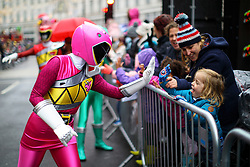© Licensed to London News Pictures. 20/11/2016. London, UK. Over 400 cast members of Hamley's Toy Parade march along Regent Street in London in a colourful extravaganza, with marching bands, dancers and toy vehicles. Photo credit: Tolga Akmen/LNP