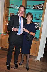 A dinner hosted by Ruinart Champagne in honour of David Linley was held at Linley, 60 Pimlico Road, London SW1 on 8th December 2011.<br /> BEN HOLLAND MARTIN and JOANNA WOOD