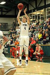 17 November 2015:  Andy Stempel(4) toes up for a 3 point attempt during an NCAA men's division 3 CCIW basketball game between the Greenville College Panthers and the Illinois Wesleyan Titans in Shirk Center, Bloomington IL