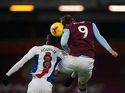 Cheikhou Kouyate of Crystal Palace (L) and Chris Wood of Burnley in action - Mandatory by-line: Jack Phillips/JMP - 23/11/2020 - FOOTBALL - Turf Moor - Burnley, England - Burnley v Crystal Palace - English Premier League
