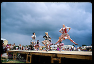 Girls leap and prance as storm clouds threaten Highland Dance contest; Stirling Highland Games Scotland