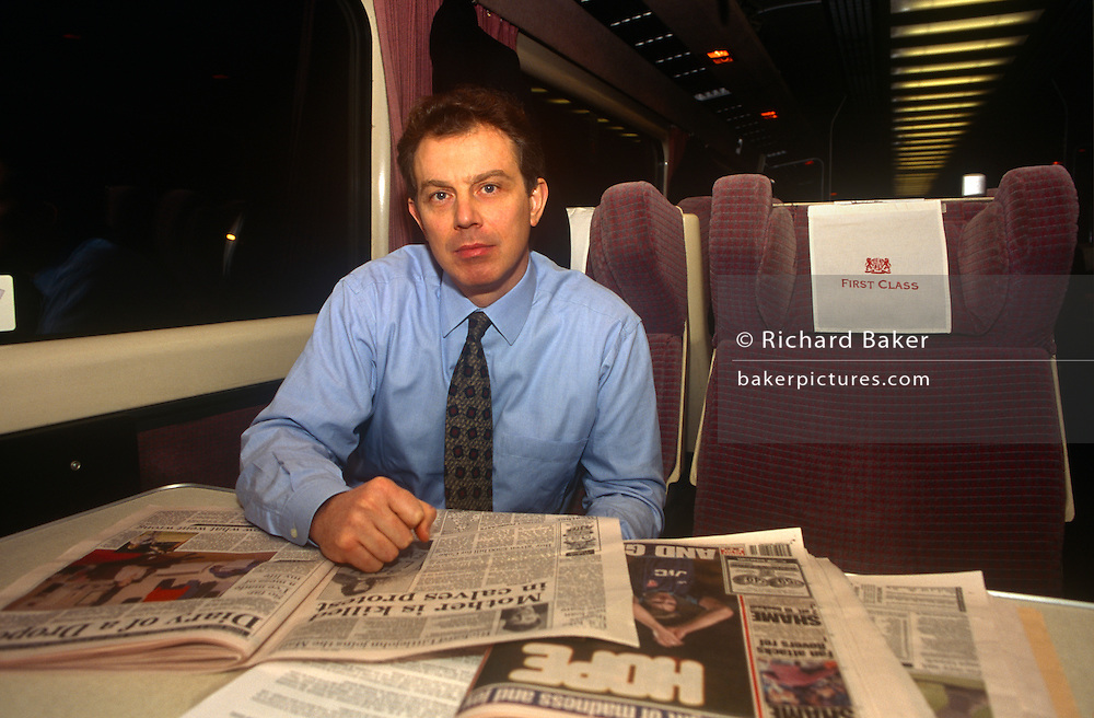 """Leader of the Opposition and future Prime Minister, the Rt. Hon. Tony Blair MP, sits reading newspapers whilst on a train en-route to an evening Labour Party rally in Nottingham, 2 years before his victory in the 1997 General Election, on 2nd February 1995 in London UK. Then, he could travel in relative obscurity, without large security details. Anthony Charles Lynton """"Tony"""" Blair (born 6 May 1953) is a British politician who served as the Prime Minister of the United Kingdom from 1997 to 2007 and the Leader of the Labour Party from 1994 to 2007."""