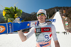 Maximilian Mechler of third placed team of Germany after the flower ceremony after the Flying Hill Team competition at 3rd day of FIS Ski Jumping World Cup Finals Planica 2012, on March 17, 2012, Planica, Slovenia. (Photo by Vid Ponikvar / Sportida.com)