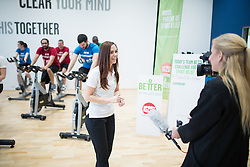 "© Licensed to London News Pictures . 01/03/2016 . Manchester , UK . Hollyoaks actress JENNIFER METCALFE (centre , being interviewed for TV) launches a national fundraiser , "" The Better Bike Challenge "" from the East Manchester Leisure Centre in Beswick . The Challenge features 10,000 people cycling one-mile , each donating £1 to #TeamBetter for Sport Relief . Photo credit : Joel Goodman/LNP"