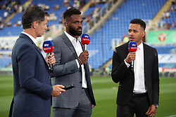 """Sky Sports presenter Scott Minto (left) with pundits Darren Bent (centre) and Liam Rosenior before the Sky Bet Championship match at the Madejski Stadium, Reading. PRESS ASSOCIATION Photo. Picture date: Friday August 3, 2018. See PA story SOCCER Reading. Photo credit should read: Andrew Matthews/PA Wire. RESTRICTIONS: EDITORIAL USE ONLY No use with unauthorised audio, video, data, fixture lists, club/league logos or """"live"""" services. Online in-match use limited to 75 images, no video emulation. No use in betting, games or single club/league/player publications."""
