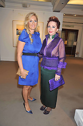 Left to right, ELENA MAKRI LIBERIS and CHRISANTHY LEMOS at a party to celebrate the publication of Elena Makri Liberis's book 'Every Month, Same day' held at Sotheby's, 34-35 New Bond Street, London on 5th May 2009.