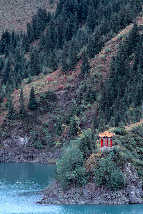 Lamp-post Hill overlooks the beautiful Lake Tianchi, also known as Heavenly Lake, in Xinjiang, China.