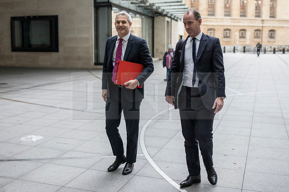 © Licensed to London News Pictures. 13/01/2019. London, UK. Secretary of State for Exiting the European Union Stephen Barclay (L) arrives at BBC Broadcasting House to appear on The Andrew Marr Show. Photo credit: Rob Pinney/LNP