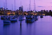 Boats moored on the Brisbane river at Sunset <br /> <br /> Editions:- Open Edition Print / Stock Image