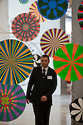 Moscow, Russia, 22/04/2011..A security guard walks through the entrance to the exhibition New York Minute at the Garage Centre for Contemporary Culture.