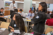 Purchase, NY – 31 October 2014. White Plains High School students Victoria Torres, left, and Jessica Simpson listening to a presentation. The Business Skills Olympics was founded by the African American Men of Westchester, is sponsored and facilitated by Morgan Stanley, and is open to high school teams in Westchester County.