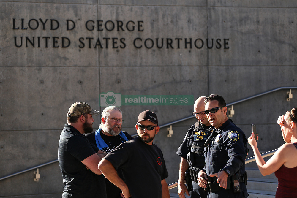 August 14, 2017 - Las Vegas, Nevada - Protestors rally outside Nevada Federal Court after a judge cut short the testimony of a defendant last week during the Bundy Standoff retrial in Las Vegas, Nevada. Eric Parker, an Idaho gun enthusiast, was photographed pointing a firearm through cement barriers on an Interstate 15 overpass overlooking a ditch where protestors gathered to face off Bureau of Land Management agents in April 2014. (Credit Image: © Joel Angel Juarez via ZUMA Wire)