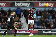 Alex Song of West Ham United heads the ball . Barclays Premier league match, West Ham Utd v Stoke city at the Boleyn Ground, Upton Park  in London on Saturday 12th December 2015.<br /> pic by John Patrick Fletcher, Andrew Orchard sports photography.