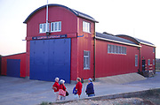 AMHJF5 Group of women chatting outside Caister on Sea lifeboat station Norfolk England
