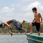 Diving into the Nile: for now it's just for fun, but for many around this age it will soon be time to dive similarly into the water and make a desperate swim for the Southern European shore.