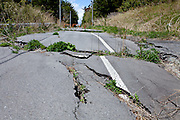 An earthquake damaged road in the town of Tomioka, Futaba District of Fukushima, Japan. Thursday May 2nd 2013. The town was evacuated on March 12th after the March 11th 2011 earthquake and tsunami cause meltdowns at the nearby Fukushima Daichi nuclear power station. It lies well within the 20 kms exclusion zone though parts of the town have recently been opened again to allow locals to visit their property during daylight hours.