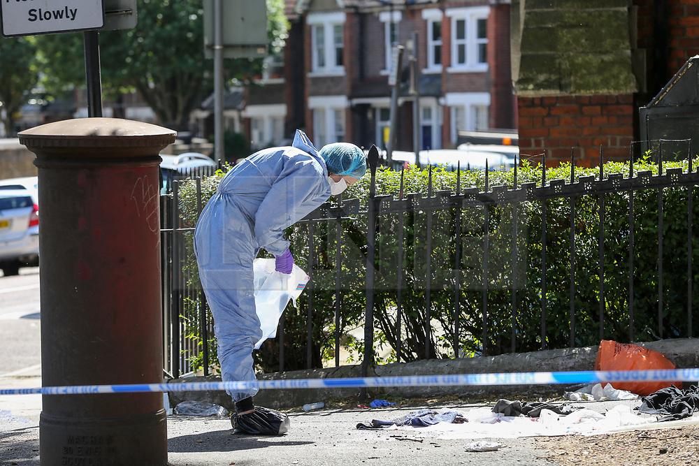 © Licensed to London News Pictures. 01/06/2019. London, UK. A forensic officer collecting the evidence on Seven Sisters Road, near the junction of Vartry Road in Haringey, north London, where a man in his 30s was found suffering from a stab wound to his leg. Police were called by London Ambulance Service just after 3am on Saturday, 1 June 2019. The victims condition in unknown.  Photo credit: Dinendra Haria/LNP