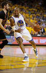 The Golden State Warriors' David West (3) works against the Cleveland Cavaliers' Kevin Love in the second quarter of Game 5 of the NBA Finals at Oracle Arena in Oakland, Calif., on Monday, June 12, 2017. (Photo by Nhat V. Meyer/Bay Area News Group/TNS) *** Please Use Credit from Credit Field ***