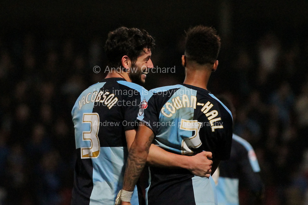 Joe Jacobson of Wycombe (left) enjoys a joke with fellow goalscorer Paris Cowan-Hall after scoring his side's third goal. Skybet football league two match, Cheltenham Town  v Wycombe Wanderers at The Abbey Business Stadium, Whaddon Road in Cheltenham, Glos on Saturday 22nd November 2014.<br /> pic by Mark Hawkins, Andrew Orchard sports photography.